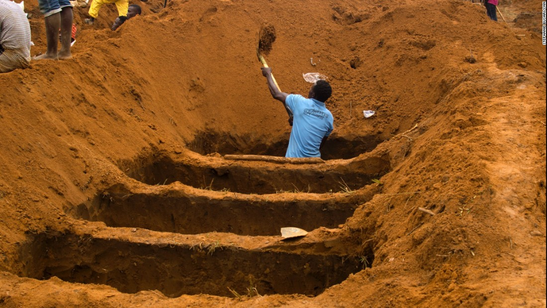 A grave digger works on August 17, at the Waterloo Cemetery in Freetown, Sierra Leone.