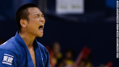 RIO DE JANEIRO, BRAZIL - AUGUST 27: Masashi Ebinuma of Japan celebrates the victory and the gold medal in the -66 kg final category during the World Judo Championships at the Maracanazinho gymnasium on August 27, 2013 in Rio de Janeiro, Brazil. (Photo by Buda Mendes/Getty Images)