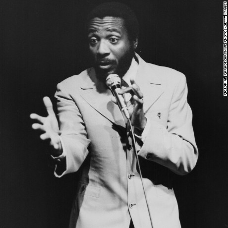 Comedian Dick Gregory performing on stage, circa 1960-1970. (Photo by Pictorial Parade/Archive Photos/Getty Images)
