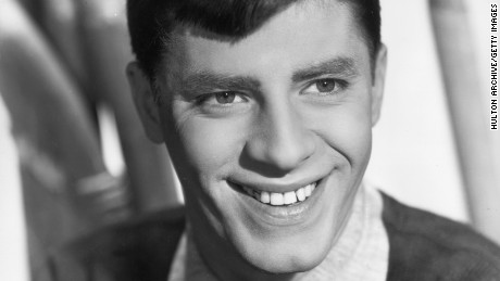 circa 1955:  Studio headshot portrait of American comedian and actor Jerry Lewis smiling in a sweater and collared shirt.  (Photo by Hulton Archive/Getty Images)
