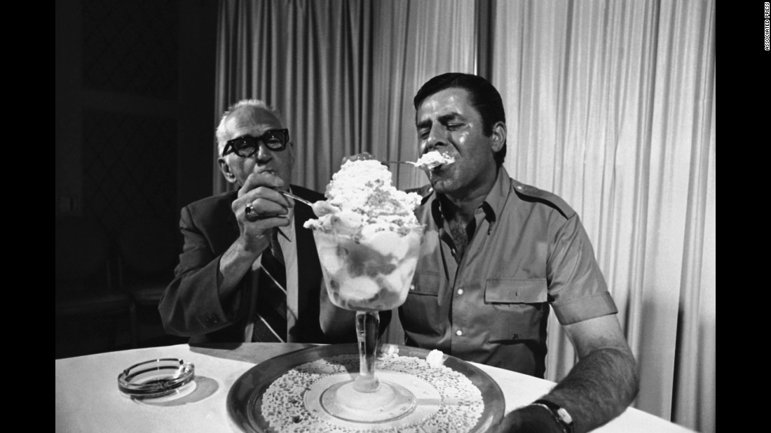 Lewis tries out a Jerry Lewis special in 1971. The ice cream special was offered by a Troy, New York, pharmacy where Lewis worked as a young man. Lewis' former boss, Ben Silberg, helps eat the giant sundae.