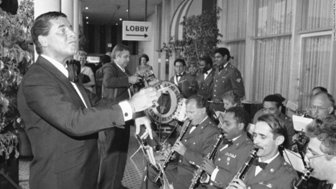Lewis performs with the United States Army Reserve Band before receiving the the military's highest civilian award in 1985. The Medal for Distinguished Service was awarded to Lewis for his role in fighting muscular dystrophy.