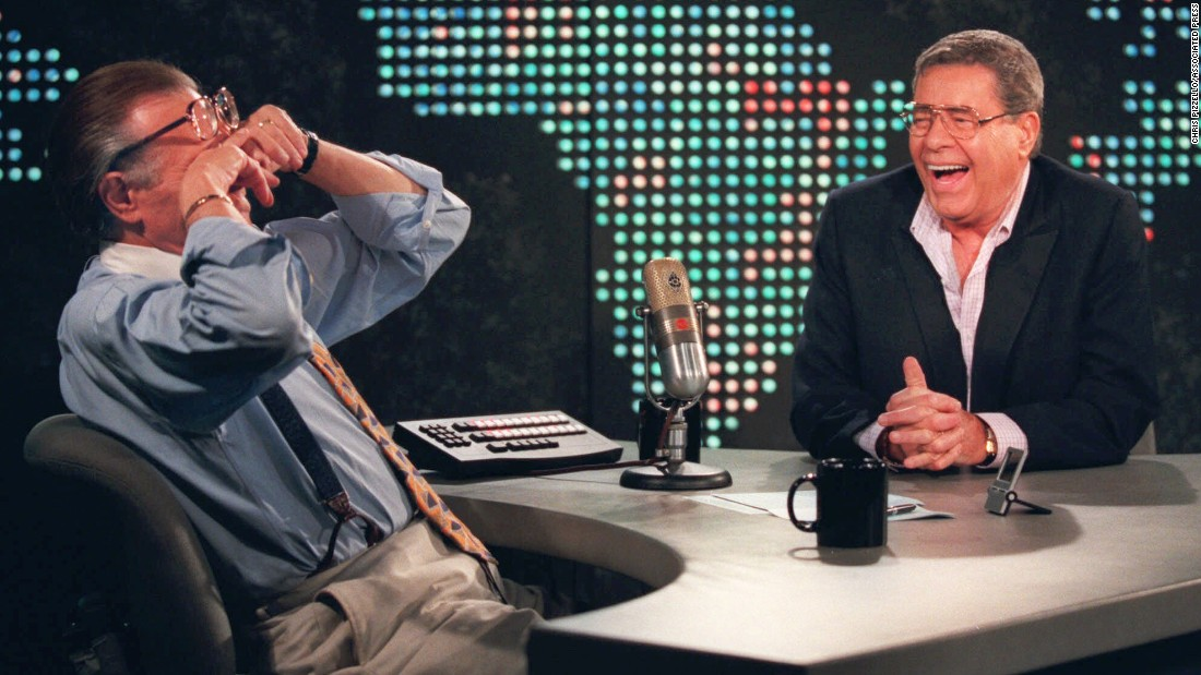 Lewis brings former CNN host Larry King to tears with a joke in 1999.