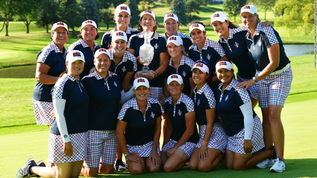 Team USA pose with the Solheim Cup after comfortably defeating Team Europe by 16.5 to 11.5.