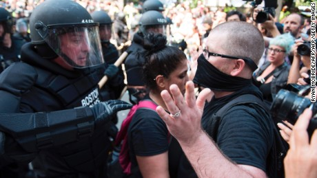 Counter-protesters of the Boston 'Free Speech' Rally clash with police as they are moved back at Boston Commons on August 19, 2017, in Boston. Thousands of anti-racism demonstrators flooded the streets of Boston Saturday, dwarfing a gathering of white nationalists in the city, triggering scuffles with police but avoiding the serious violence that marred a similar event a week earlier in Virginia. / AFP PHOTO / Ryan McBride        (Photo credit should read RYAN MCBRIDE/AFP/Getty Images)