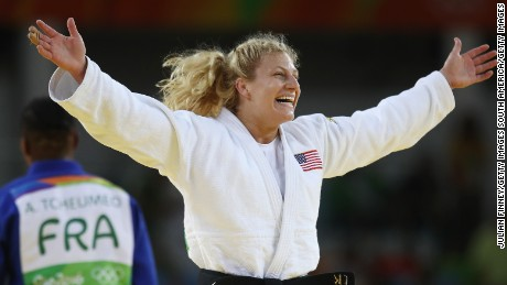 Kayla Harrison celebrates after defeating Audrey Tcheumeo in the Rio 2016 -78kg Olympic gold medal contest.