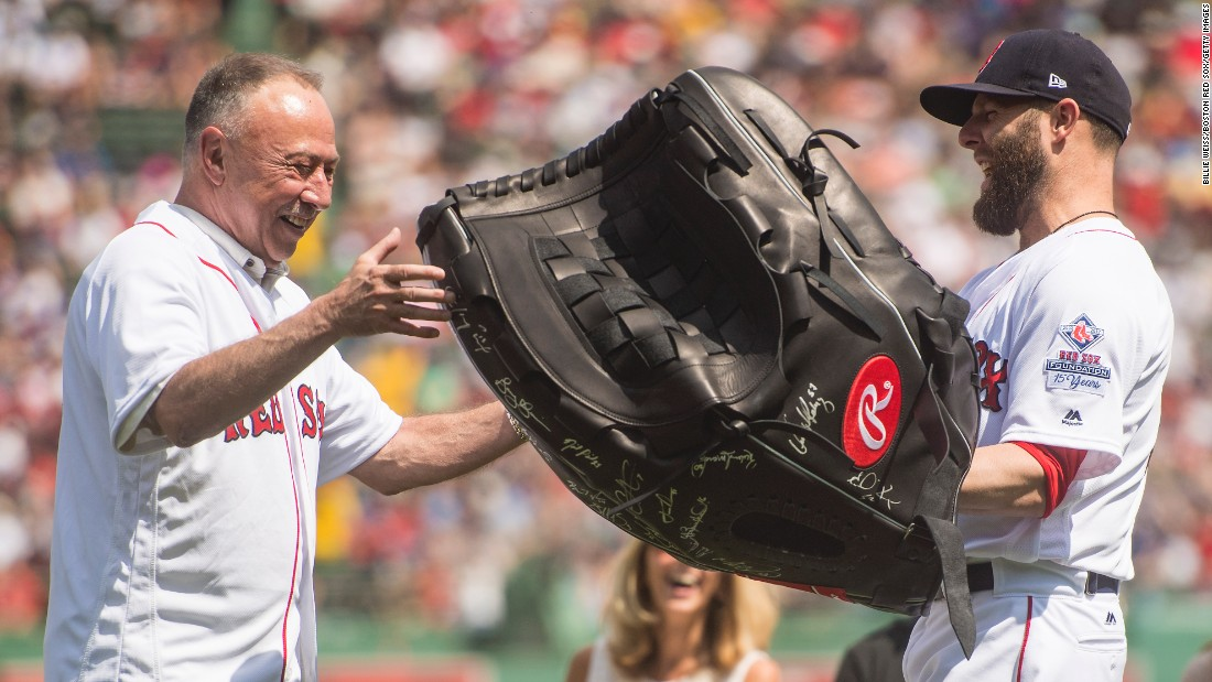 "Boston second baseman Dustin Pedroia presents NESN broadcaster Jerry Remy with a giant glove during a pregame ceremony on Sunday, August 20. Remy, <a href=""http://nesn.com/2017/08/jerry-remy-eyeing-opening-day-2018-return-to-broadcasting-booth/"" target=""_blank"">who is battling lung cancer,</a> has been calling Red Sox games for 30 years."