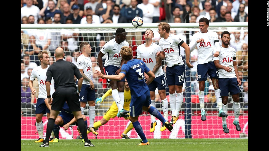 Marcos Alonso whips a free kick over a Tottenham wall, scoring the first goal in Chelsea's 2-1 victory in London on Sunday, August 20. He scored the winning goal as well.