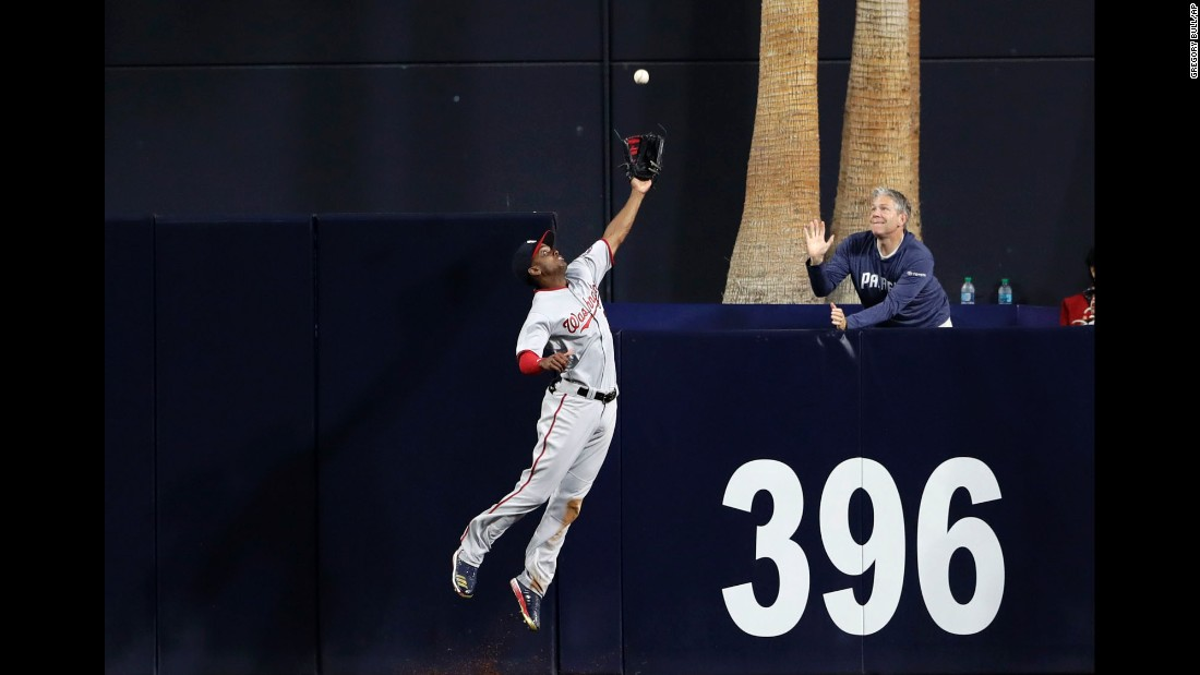 Washington center fielder Michael Taylor makes a catch at the wall during a Major League Baseball game in San Diego on Friday, August 18.