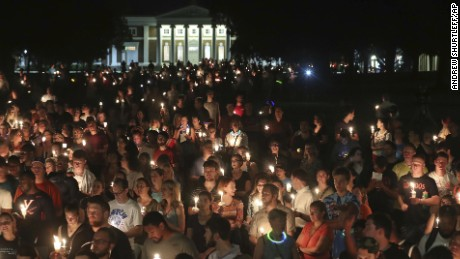 University of Virginia students, faculty and residents attend a candlelight march on campus on Wednesday, August 16 -- four days after Charlottesville erupted in chaos during a white nationalist rally.