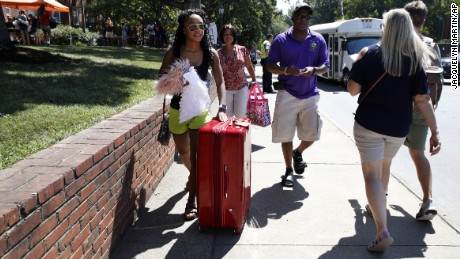 Malia Valentine, 18, of Yorktown, Virginia, and her parents move her into her new dorm at the University of Virginia on Friday.