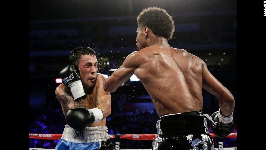 Shakur Stevenson, right, punches David Paz during their super-featherweight bout in Lincoln, Nebraska, on Saturday, August 19. Stevenson won by unanimous decision.