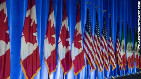 The flags of Canada, the United States, and Mexico, line the stage before the start of the negotiations for the modernization of NAFTA, August 16, 2016, in Washington, DC. Negotiators from Canada, Mexico and the United States opened the first round of talks Wednesday to revamp the 23-year-old regional free trade agreement some see as a demon and others as a savior. / AFP PHOTO / PAUL J. RICHARDS        (Photo credit should read PAUL J. RICHARDS/AFP/Getty Images)