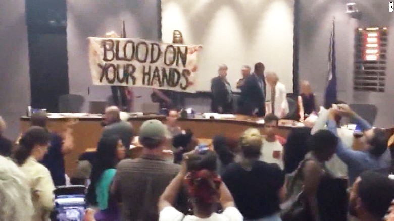 Protesters interrupt city council meeting