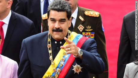Venezuelan President Nicolas Maduro (C) arrives at the Congress with his wife Cilia Flores (L), the head of the Constituent Assemby, Delcy Rodriguez (R), and other authorities, to address the all-powerful pro-Maduro assembly which has been placed over the National Assembly and tasked with rewriting the constitution, in Caracas on August 10, 2017. Recent demonstrations in Venezuela have stemmed from anger over the installation of the all-powerful Constituent Assembly that many see as a power grab by the unpopular President Maduro. The dire economic situation also has stirred deep bitterness as people struggle with skyrocketing inflation and shortages of food and medicine.  / AFP PHOTO / Ronaldo SCHEMIDT        (Photo credit should read RONALDO SCHEMIDT/AFP/Getty Images)