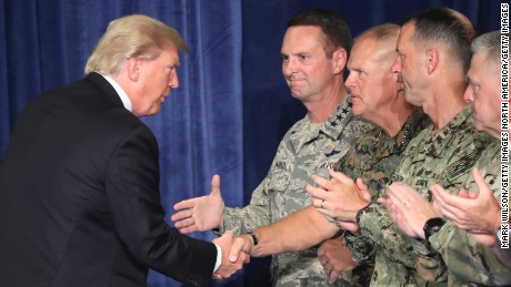ARLINGTON, VA - AUGUST 21:  U.S. President Donald Trump greets military leaders before his speech on Afghanistan at the Fort Myer military base on August 21, 2017 in Arlington, Virginia. Trump was expected to announce a modest increase in troop levels in Afghanistan, the result of a growing concern by the Pentagon over setbacks on the battlefield for the Afghan military against Taliban and al-Qaeda forces.  (Photo by Mark Wilson/Getty Images)