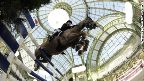 Australian Edwina Alexander, riding Cevo Itot Du Chateau, competes during the International Jumping Competition on April 4, 2010, at The Grand Palais in Paris. Edwina Alexander finished 6th and German Marcus Ehning won the event.  AFP PHOTO / FRANCK FIFE (Photo credit should read FRANCK FIFE/AFP/Getty Images)