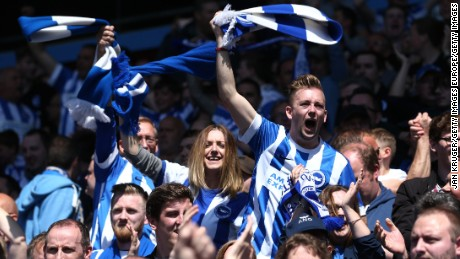 BIRMINGHAM, ENGLAND - MAY 07: Brighton and Hove Albion fans celebrate after their side scores their first goal during the Sky Bet Championship match between Aston Villa and Brighton & Hove Albion at Villa Park on May 7, 2017 in Birmingham, England.  (Photo by Jan Kruger/Getty Images)