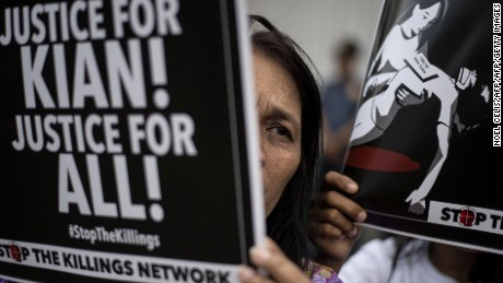 An activist holds a poster against extra-judicial killings during a protest in Manila in August 2017.