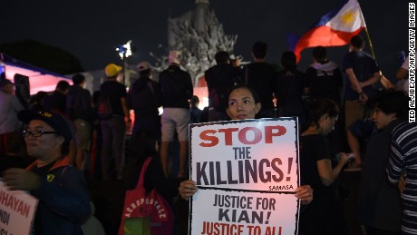 Protesters take part in a demonstration against the killings of suspected drug users allegedly by police during anti-drugs raids at the People Power monument in Manila on August 21, 2017.