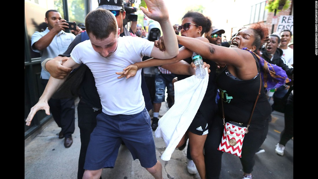 "A counterprotester takes a swing at a man who was taking part in what organizers described as a free-speech rally in Boston on Saturday, August 19. The rally came one week after racially motivated protests in Charlottesville, Virginia, turned deadly. <a href=""http://www.cnn.com/2017/08/19/us/boston-free-speech-rally/index.html"" target=""_blank"">Thousands of people marched</a> in opposition to the rally."