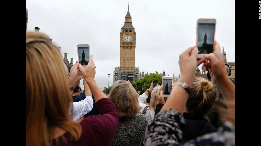 "People record Big Ben's last bell-ringing in London on Monday, August 21. The Elizabeth Tower <a href=""http://www.cnn.com/2017/08/14/europe/big-ben-silent-four-years/index.html"" target=""_blank"">is being renovated</a> for the next four years."