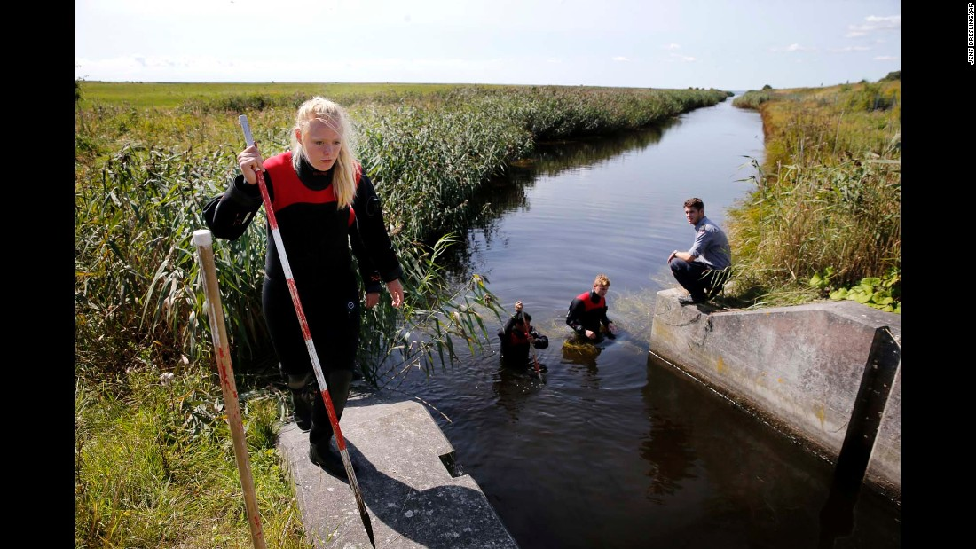 "Authorities search a waterway near Copenhagen, Denmark, on Wednesday, August 23. DNA from a headless torso that washed up on an island near Copenhagen matches that of missing Swedish journalist Kim Wall, police said. Wall, 30, was last seen with inventor Peter Madsen on his private submarine earlier this month. Madsen <a href=""http://www.cnn.com/2017/08/24/europe/kim-wall-denmark-madsen-murder/index.html"" target=""_blank"">is to be charged with murder,</a> Danish prosecutor Jakob Buch-Jepsen told CNN. Madsen told a closed-door court hearing that Wall had died in an accident and was buried at sea in an ""unspecified place"" in Køge Bay, according to a statement."