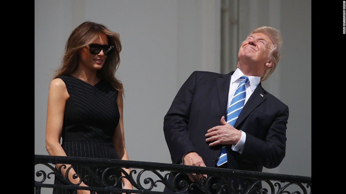 "US President Donald Trump <a href=""http://www.cnn.com/2017/08/21/politics/trump-solar-eclipse/index.html"" target=""_blank"">looks up at the sky</a> during the total solar eclipse on Monday, August 21. He eventually put on protective glasses as he watched the eclipse with his wife, Melania, and their son Barron, from the White House South Portico."