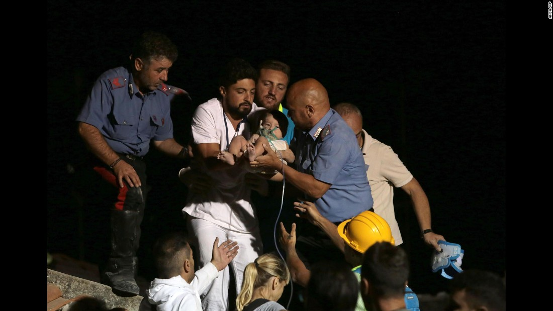 "Rescuers pull a 7-month-old boy from the rubble of a collapsed building in Casamicciola, Italy, a day after <a href=""http://www.cnn.com/2017/08/21/world/italy-earthquake-gulf-of-naples/index.html"" target=""_blank"">an earthquake hit the island of Ischia</a> on Monday, August 21. The boy's parents and his two brothers were also saved."