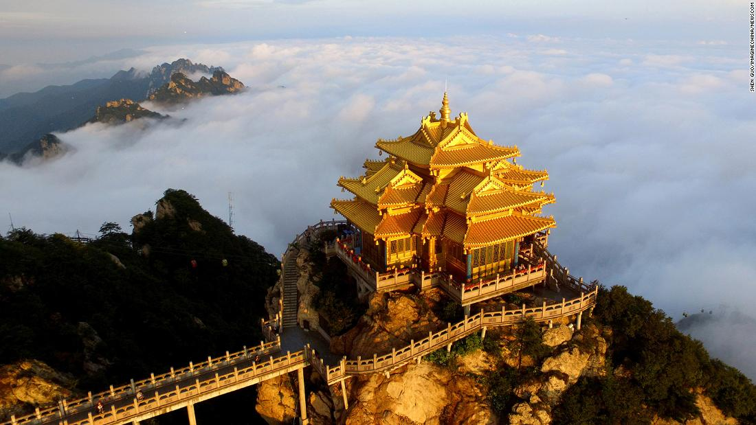 <strong>Henan, China:</strong> The pavilion atop Laojun Mountain towers over the city of Luoyang, when not obscured by clouds. The beautiful limestone peak, connected by cable car, is a popular tourist attraction in the area.