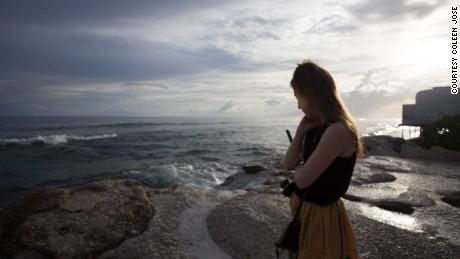 Kim Wall stands on a roadside in Majuro, the capital of the Marshall Islands. Along with reporting partners, she was investigating the impacts of climate change and the legacy of nuclear testing on the Marshall Islands in 2015.