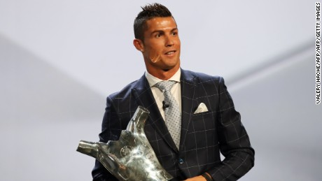 Real Madrid's Portuguese forward Cristiano Ronaldo poses with his trophy of Best Men's player in Europe at the end of the UEFA Champions League Group stage draw ceremony, on August 25, 2016 in Monaco. AFP PHOTO / VALERY HACHE / AFP / VALERY HACHE        (Photo credit should read VALERY HACHE/AFP/Getty Images)