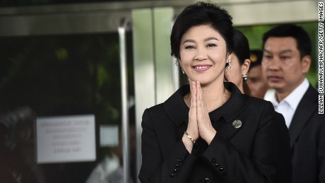 Former Thai prime minister Yingluck Shinawatra greets her supporters as she leaves the Supreme Court in Bangkok on July 21, 2017. Toppled Thai premier Yingluck Shinawatra was mobbed on July 21 by well-wishers, many bearing red roses, as she arrived for what could be the final hearing of a trial for criminal negligence that carries a 10-year jail term. / AFP PHOTO / LILLIAN SUWANRUMPHA        (Photo credit should read LILLIAN SUWANRUMPHA/AFP/Getty Images)