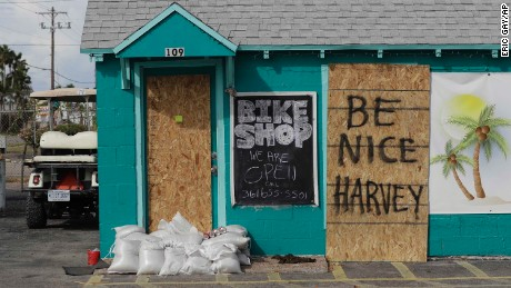 "A sign reading ""Be Nice Harvey"" was left behind on a boarded up business, Thursday, Aug. 24, 2017, in Port Aransas, Texas. Port Aransas is under a mandatory evacuation for Hurricane Harvey. (AP Photo/Eric Gay)"