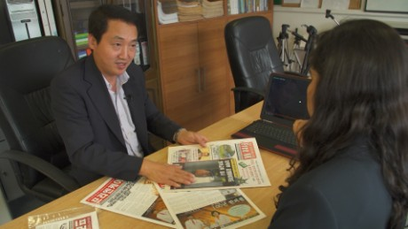 Joo Il Kim shows CNN a copy of Free NK.