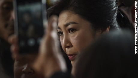Former Thai prime minister Yingluck Shinawatra arrives at the Constitutional Court to stand trial for negligence over a rice pledging scheme in Bangkok on November 4, 2016.   Hundreds of people mobbed Yingluck as she arrived at court. / AFP / LILLIAN SUWANRUMPHA        (Photo credit should read LILLIAN SUWANRUMPHA/AFP/Getty Images)