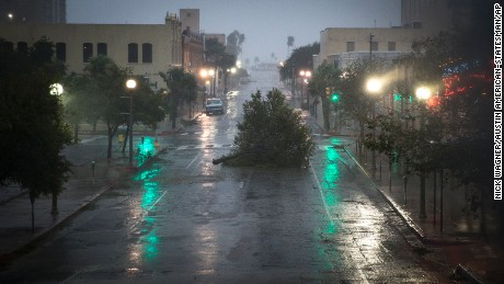 A tree blocks a street as Hurricane Harvey makes landfall in Corpus Christi, Texas, on Friday, Aug. 25, 2017. Hurricane Harvey smashed into Texas late Friday, lashing a wide swath of the Gulf Coast with strong winds and torrential rain from the fiercest hurricane to hit the U.S. in more than a decade.  (Nick Wagner /Austin American-Statesman via AP)