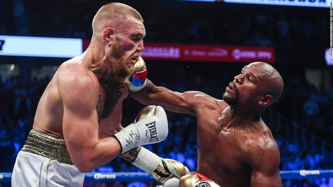 "Floyd Mayweather Jr. lands a right hand against Conor McGregor during their boxing match in Las Vegas on Saturday, August 26. Mayweather <a href=""http://www.cnn.com/2017/08/27/sport/mayweather-vs-mcgregor-fight/index.html"" target=""_blank"">stopped McGregor in the 10th round,</a> collecting his 50th victory in what he said will be the last fight of his undefeated pro career. It was the first pro boxing match for McGregor, a mixed martial artist who is the UFC's lightweight champion."