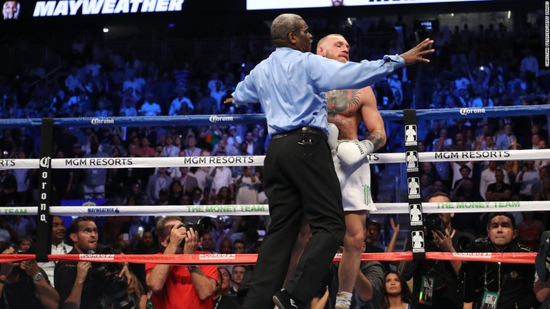 Referee Robert Byrd stopped the fight in the 10th after a wobbly McGregor took several hard shots and wasn't throwing punches.