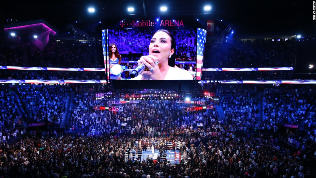 Demi Lovato sang the national anthem before the fight.