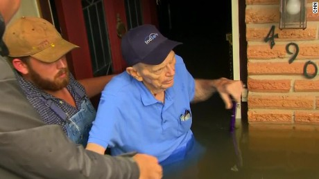 Elderly couple rescued from flooded home