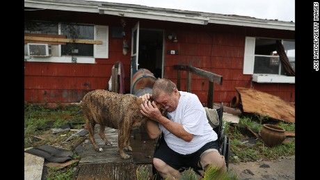 "Steve Culver cries with his dog Otis as he talks about the ""most terrifying event in his life,"" when Hurricane Harvey destroyed most of his home while he and his wife took shelter there on August 26, 2017 in Rockport, Texas."