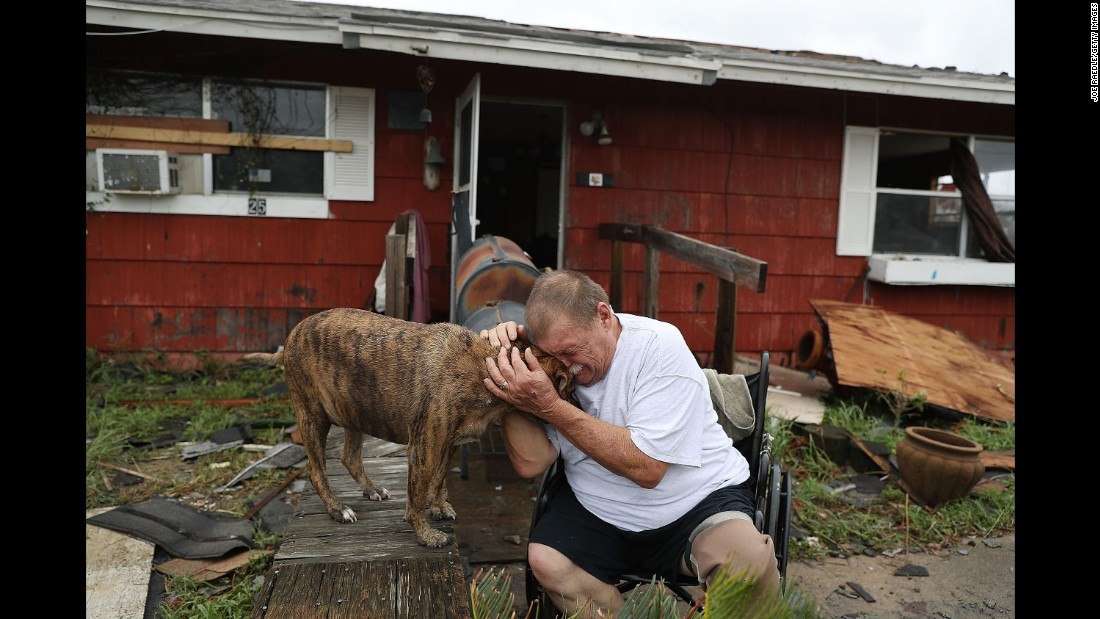 "Steve Culver comforts his dog Otis on August 26 as he talks about what he said was the ""most terrifying event in his life."" Hurricane Harvey destroyed most of his home in Rockport while he and his wife were there."