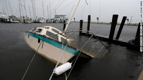 A boat lies crippled Saturday in Rockport's marina in the aftermath of Hurricane Harvey.