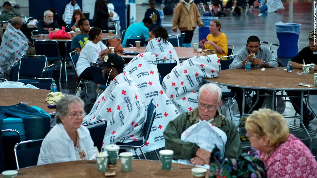 Houston flood victims eat and rest at the George R. Brown Convention Center on August 28.