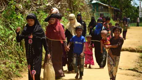 Amena Khatun, second from the left, and her family enter Balukhali camp in Cox's Bazar, Bangladesh.