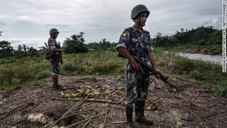 This photo taken on July 14, 2017 shows border police standing guard at Tinmay village, Buthidaung township in Myanmar's northern Rakhine state. Hemmed in by Myanmar security forces and menaced by abductions and killings, Rohingya Muslims in a conflict-scarred corner of Rakhine State say fear is one of the few constants in their lives.  / AFP PHOTO / HLA HLA HTAY / TO GO WITH Myanmar-Bangladesh-killings-unrest by HLA HLA HTAY        (Photo credit should read HLA HLA HTAY/AFP/Getty Images)