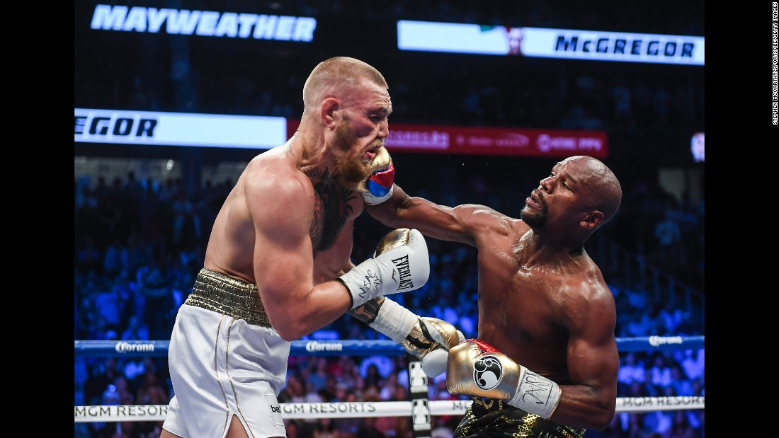 "Floyd Mayweather Jr. lands a right hand against Conor McGregor during their boxing match in Las Vegas on Saturday, August 26. Mayweather stopped McGregor in the 10th round, collecting his 50th victory in what he said will be the last fight of his undefeated pro career. It was the first pro boxing match for McGregor, a mixed martial artist who is the UFC's lightweight champion. <a href=""http://www.cnn.com/2017/08/27/sport/gallery/mayweather-mcgregor/index.html"" target=""_blank"">See more photos from the fight</a>"