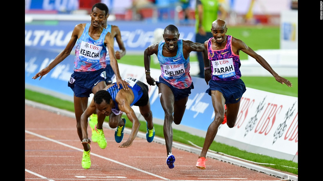 Ethiopia's Muktar Edris falls over the finish line during a 5,000-meter race in Zurich, Switzerland, on Thursday, August 24. British runner Mo Farah, right, finished first in what was the final race of his legendary career.