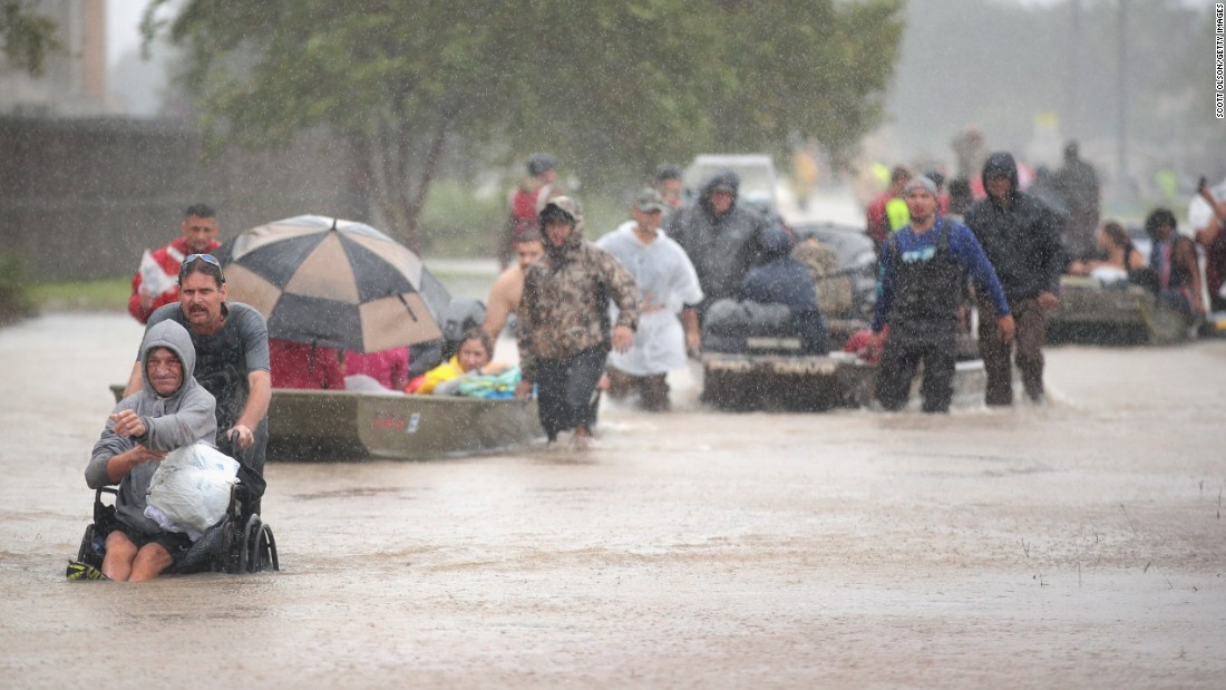 People are rescued in Houston on August 28.
